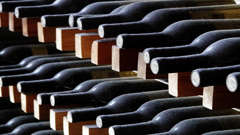 racks-of-wine-bottles-in-a-cellar