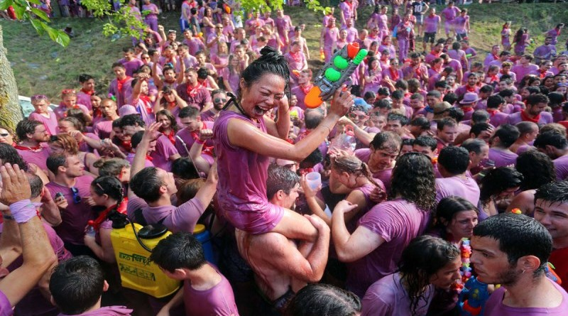 "Covered in wine revellers enjoy during the""Batalla del Vino"" (Battle of Wine) in Haro, on June 29, 2015. Every year thousands of locals and tourists climb a mountain in the northern Spanish province of La Rioja to celebrate St. Peter's day covering each other in red wine while tanker trucks filled with wine distribute the alcoholic beverage to water pistols, back mounted spraying devices, buckets which are randomly poured on heads and into any other available container. More than nine thousand people threw around 130,000 litres of wine during this year's Haro Wine Fest"