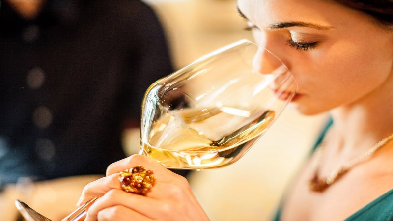 young woman enjoying white wine