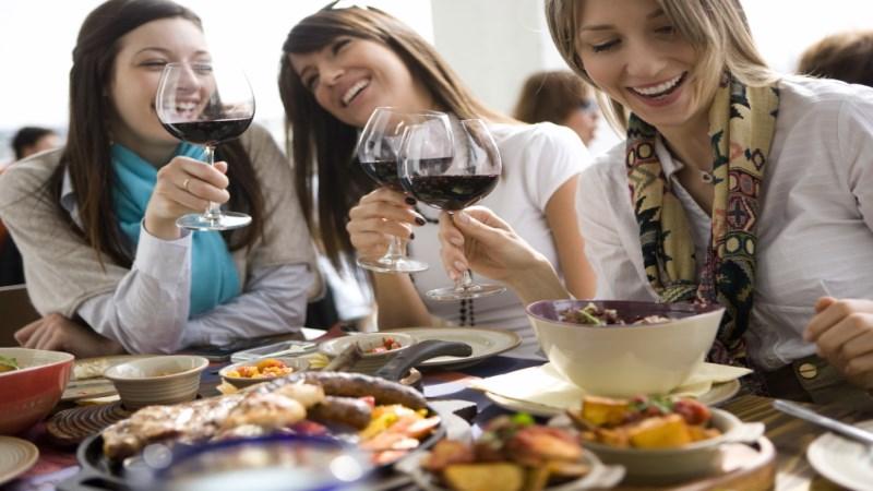 young woman enjoying white wine